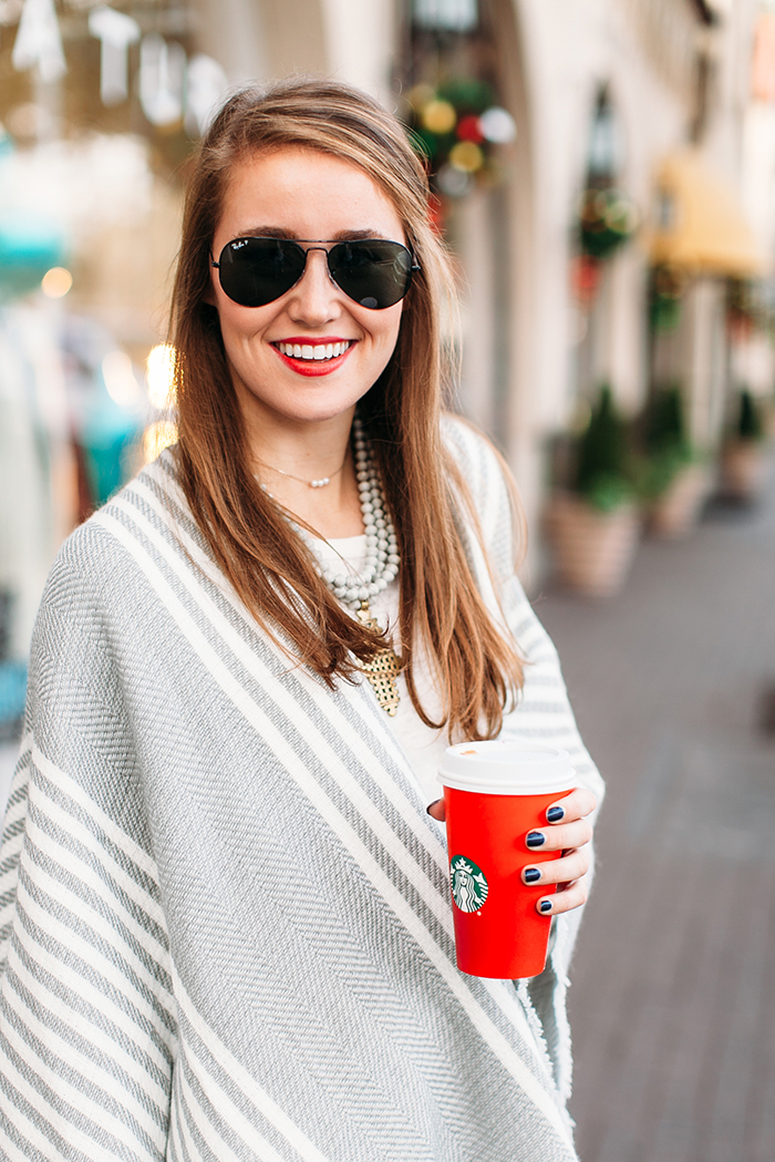 grey striped poncho, black raybans