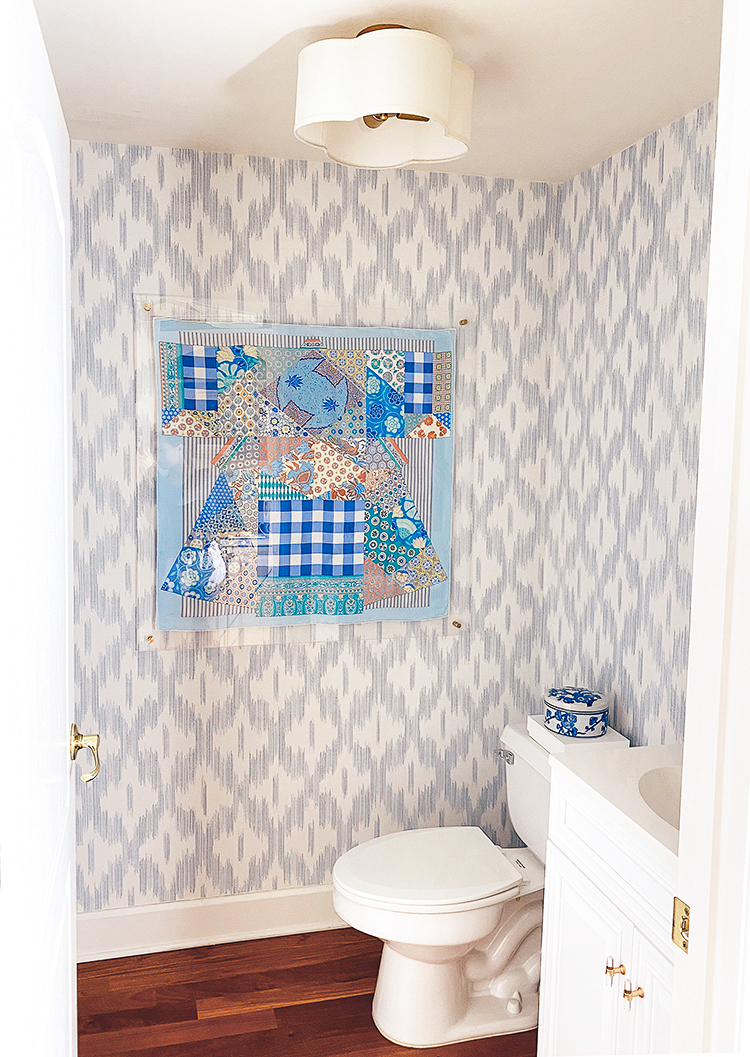 keller ogee blue ikat wallpaper, scalloped light, hermes scarf frame, serena and lily lanai mirror, bamboo mirror, blue and white powder bath, bathroom renovation