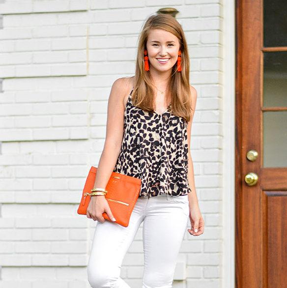 leopard halter top, leopard top, cheetah halter top, cheetah print, leopard print, orange tassel earrings, lisi lerch tassel earrings, gigi new york clutch, orange clutch, white jeans, southern style, preppy girl style