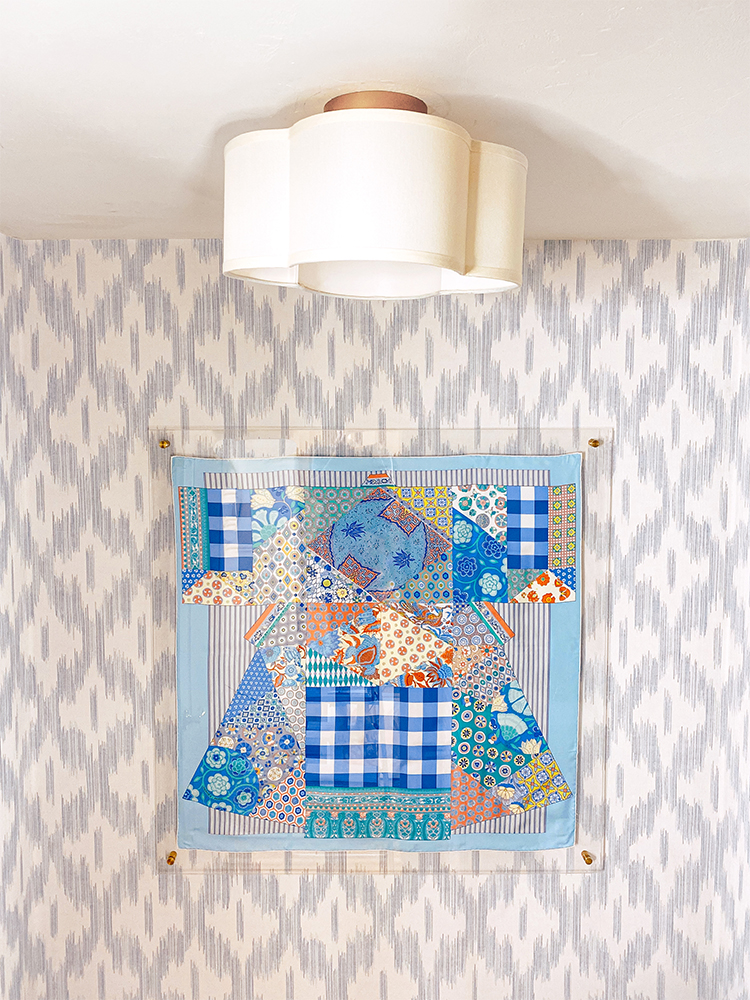keller ogee blue ikat wallpaper, scalloped light, hermes scarf frame, serena and lily lanai mirror, bamboo mirror, blue and white powder room, bathroom renovation, monogrammed hand towel, amanda lindroth design woven hurricane glass
